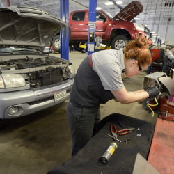 "Auto technician Becky McInnis changes the inflator module on a 2003 Toyota Tundra at Lee Toyota in Topsham on Thursday. Japanese auto supplier Takata has issued recalls on 34 million airbags, but so far ""customers are slightly less concerned than you may think,"" said Adam Lee, owner of Lee Auto Malls."