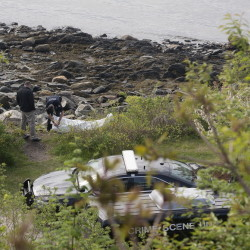 Police investigate the scene where a woman's body was found on the Portland shore near Fort Allen Park on Friday.