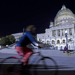 The U.S. Capitol is illuminated Friday night as the Senate works late on important bills that require action.