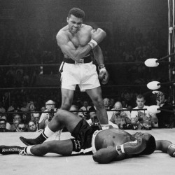 Heavyweight champion Muhammad Ali stands over fallen challenger Sonny Liston in the first round of their title fight in Lewiston 50 years ago.