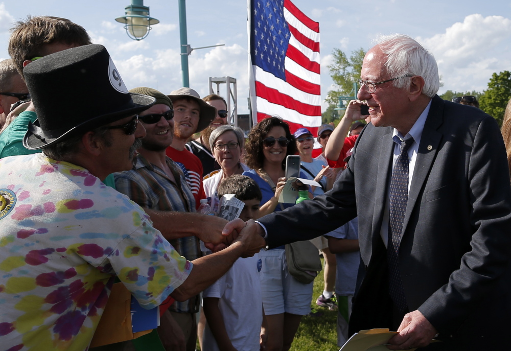 Sen. Bernie Sanders, shown greeting supporters Tuesday in Burlington, Vt., is laying out an agenda in step with the Democratic Party's progressive wing.