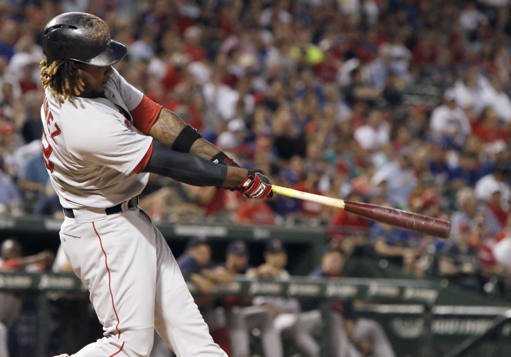 Red Sox designated hitter Hanley Ramirez hits a solo home run in the sixth inning of Thursday night's game against the Texas Rangers. The home run helped Boston to a 5-0 win.