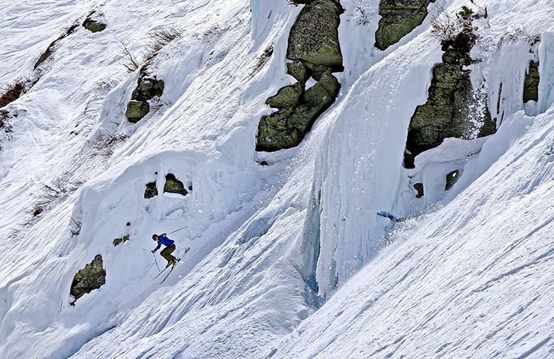 Silas Miller, 28, of Conway, N.H. sails more than 50 feet off an ice-covered cliff on the Headwall of Tuckerman Ravine on Mount Washington in May.