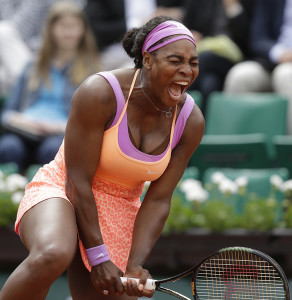 Serena Williams of the U.S. screams in the second round match of the French Open tennis tournament against Germany's Anna-Lena Friedsam at the Roland Garros stadium, in Paris, France, Thursday, May 28, 2015. Williams won in three sets 5-7, 6-3, 6-3. (AP Photo/Thibault Camus)
