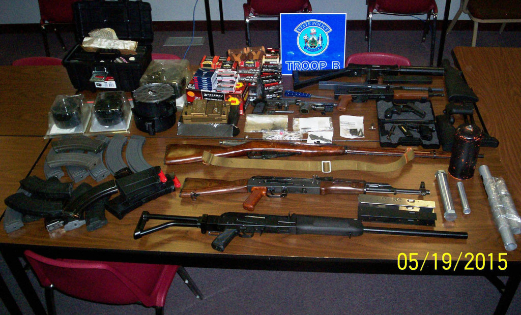 Police say Guy Schultz of Leeds had handguns, rifles and shotguns in his home, and equipment like silencers.