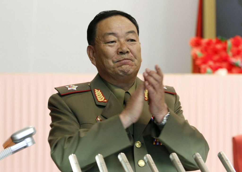 Vice Marshal Hyon Yong Chol applauds during a meeting at the House of Culture announcing North Korean leader Kim Jong Un's new title of marshal in this July 18, 2012, photo. The Associated Press