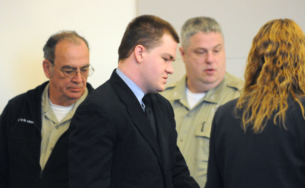 Kyle Dube is escorted into the courtroom at the Penobscot Judicial Center before his sentencing on Friday. Dube, who used a phony Facebook profile to lure 15-year old Nichole Cable to her death, was sentenced to 60 years in prison.