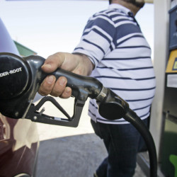 Juan Zuniga gasses up a SUV in Dallas on Thursday. Gasoline prices rose more than 2 cents on Thursday to a new national average of $3.228 per gallon.