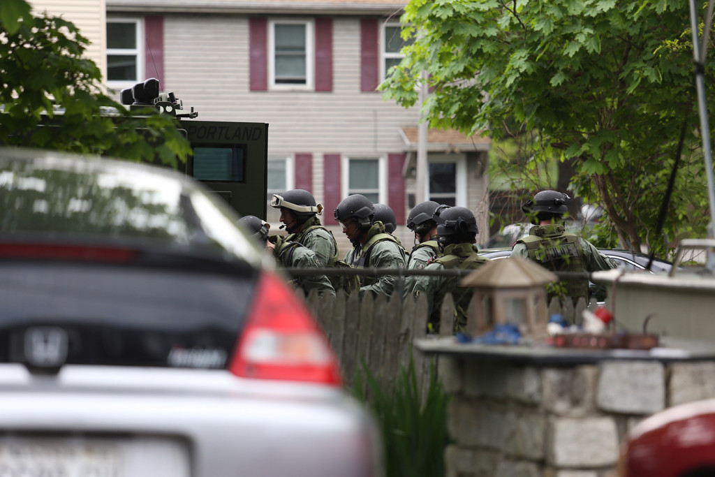 Portland police reaction team on scene in East Deering. Heavily armed police congregated at the rear of a house on Washington Avenue. Whitney Hayward / Staff Photographer