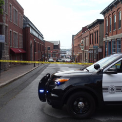Police on the the scene of a shooting early Tuesday in Portland's Old Port. Whitney Hayward/Staff Photographer