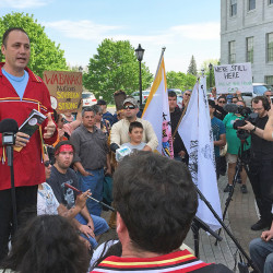 Chief Kirk Francis of the Penobscot Nation speaks Tuesday during a rally outside of the State House about the Penobscot and Passamaquoddy tribes' decision to withdraw their representatives from the Legislature. Photo by Kevin Miller / Staff Writer