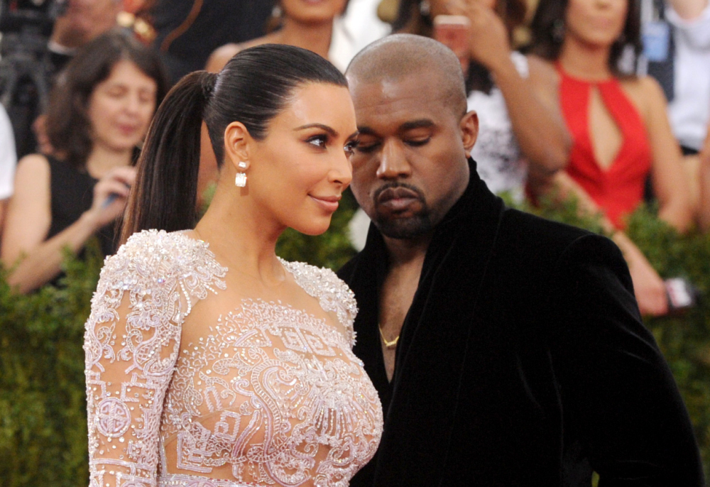 This May 4, 2015, file photo shows Kim Kardashian, left, and Kanye West arriving at The Metropolitan Museum of Art's Costume Institute benefit gala in New York.