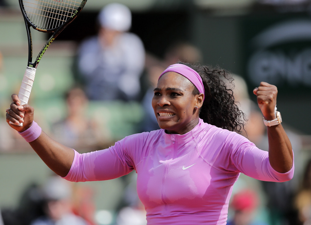 Serena Williams of the U.S. reacts as she defeats compatriot Sloane Stephens during their fourth round match of the French Open tennis tournament at the Roland Garros stadium, Monday, in Paris.