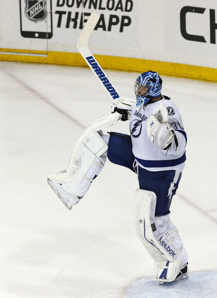 AP photo   Tampa Bay Lightning goalie Ben Bishop reacts as time winds off the clock to give the Lightning a 2-0 win over the Rangers in Game 7 of the Eastern Conference finals. Bishop played three seasons at the University of Maine, going 55-34-7.