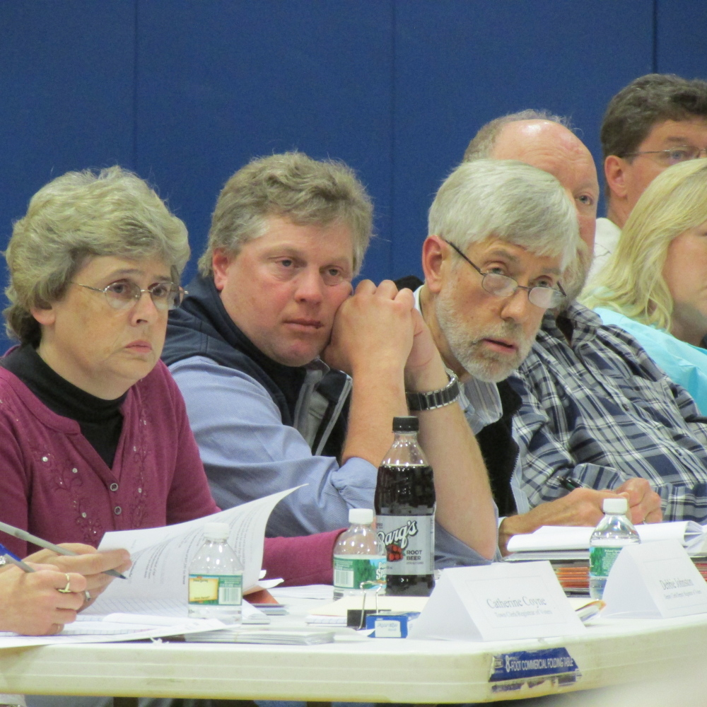 Vassalboro Town Manager Mary Sabins and Selectmen Robert Browne and Philip Haines listen to a resident's question at annual town meeting held Monday evening at the Vassalboro Community School.