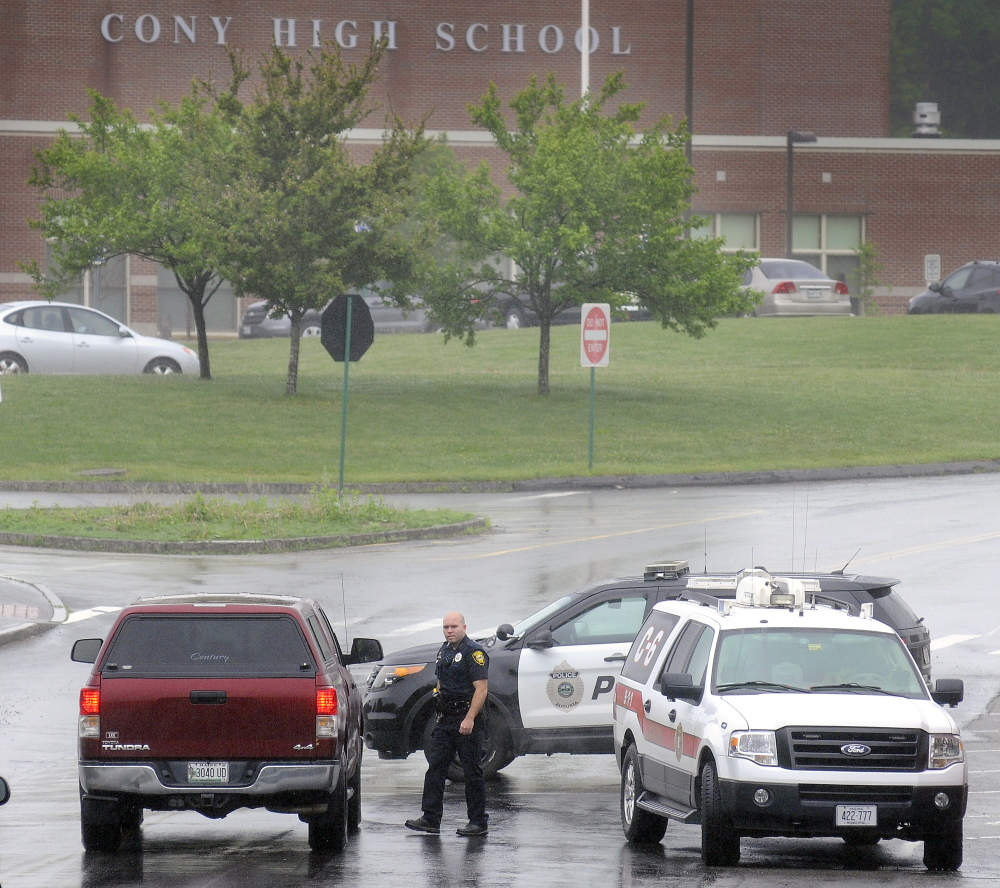 Augusta police and firefighters block the exterior of Cony High School in Augusta on Tuesday after an evacuation of faculty, students and staff because of a perceived threat.