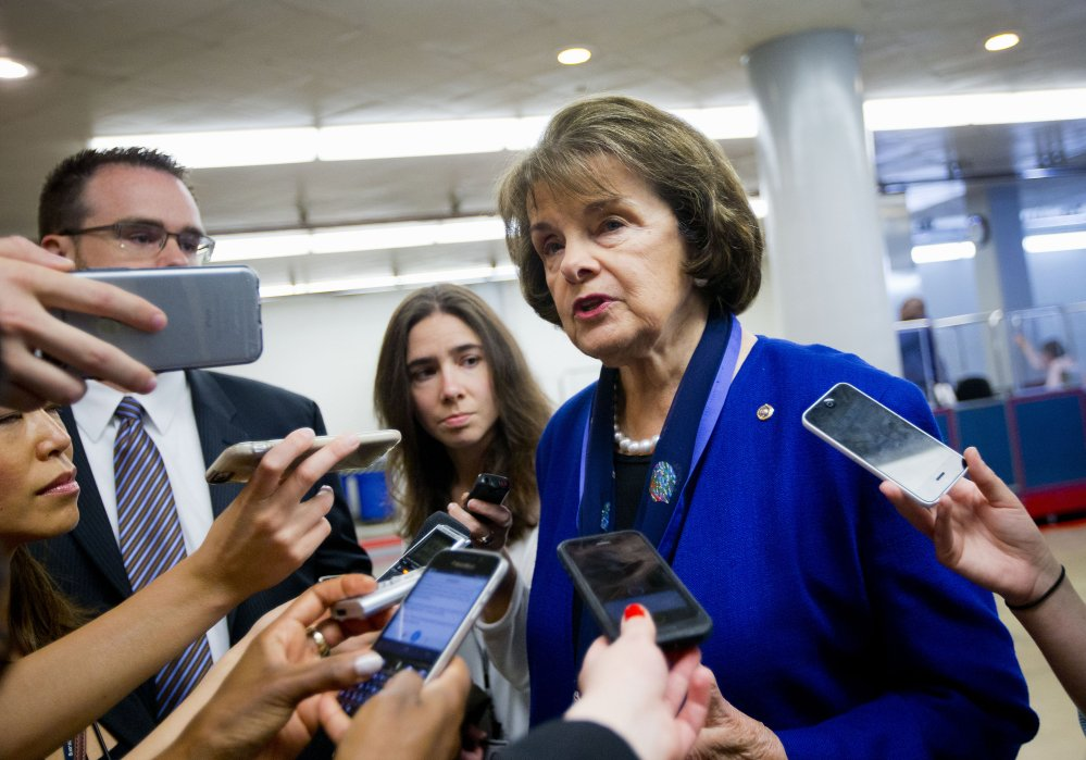 Senate Intelligence Committee Vice Chair Sen. Dianne Feinstein, D-Calif., speaks with reporters on Capitol Hill in Washington on Tuesday. Congress remade the post-9/11 surveillance program and sent the new legislation to President Barack Obama for his signature.