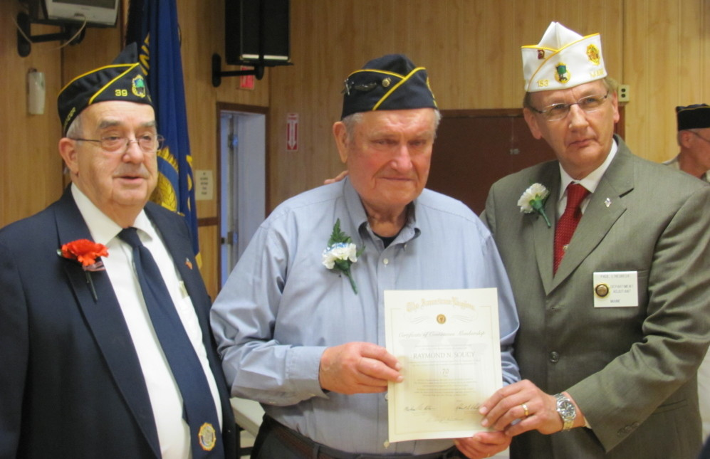 Legion member Raymond Soucy, of Madison, center, recently was presented a certificate for being a member of the American Legion for 70 continuous years, by Post Commander H. Ralph Withee, left, and Department of Maine Adjutant, Paul L'Heureux, right.