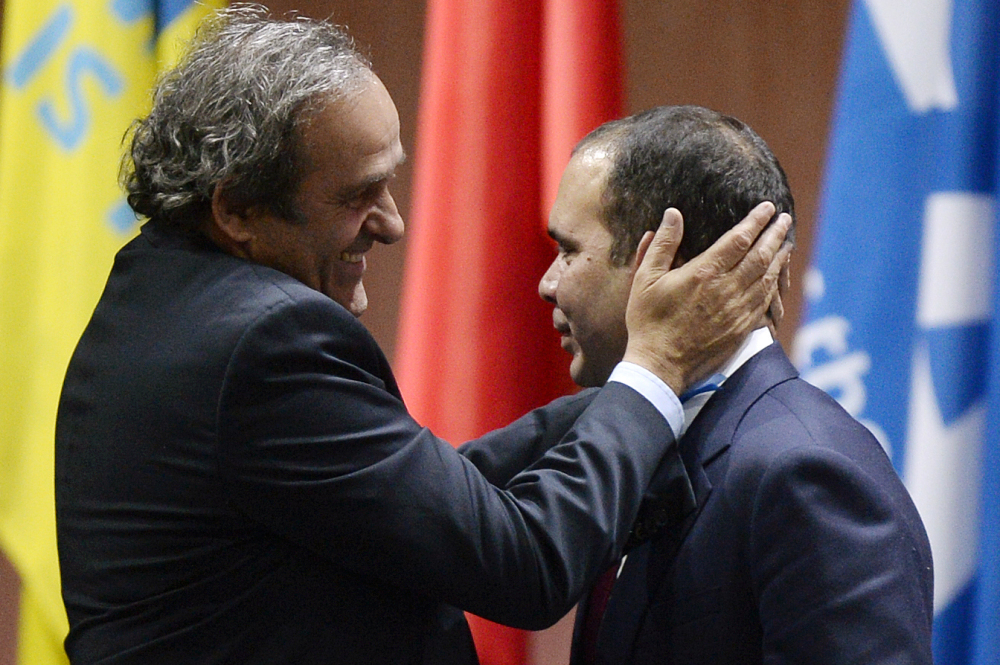 Prince Ali bin al-Hussein, right, is embraced by UEFA President Michel Platini, left, after al-Hussein announced his withdrawal in the FIFA president election at the 65th FIFA Congress at the Hallenstadion in Zurich, Switzerland last week. Michel Platini and al-Hussein are the likely candidates to succeed Sepp Blatter. But in an election where Africa and Asia hold almost half the votes, Cameroon's Issa Hayatou and others may enter the race.