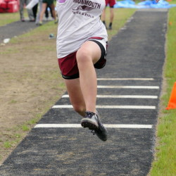 Maddie Amero competes in the triple jump during the Mountain Valley Conference track and field championships Tuesday at Lisbon High School.