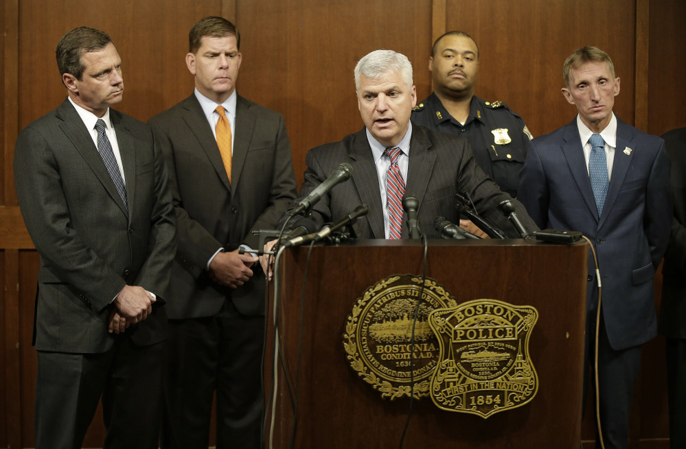 The Associated Press Suffolk County District Attorney Daniel F. Conley speaks as FBI Special Agent in Charge of Boston Vincent B. Lisi, left to right, Boston Mayor Marty Walsh and Boston Police Commissioner William B. Evans, far right, look on during a joint news conference at the Boston Police Department's Headquarters Tuesday in Boston.