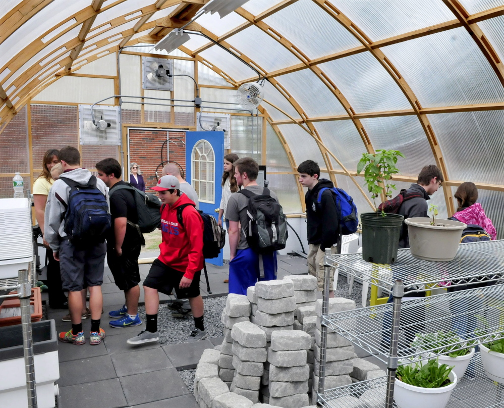 Messalonskee students enter and tour the new greenhouse during an official opening Wednesday at the Oakland school. Students, staff members, area businesses and organizations and grant money helped build the greenhouse.
