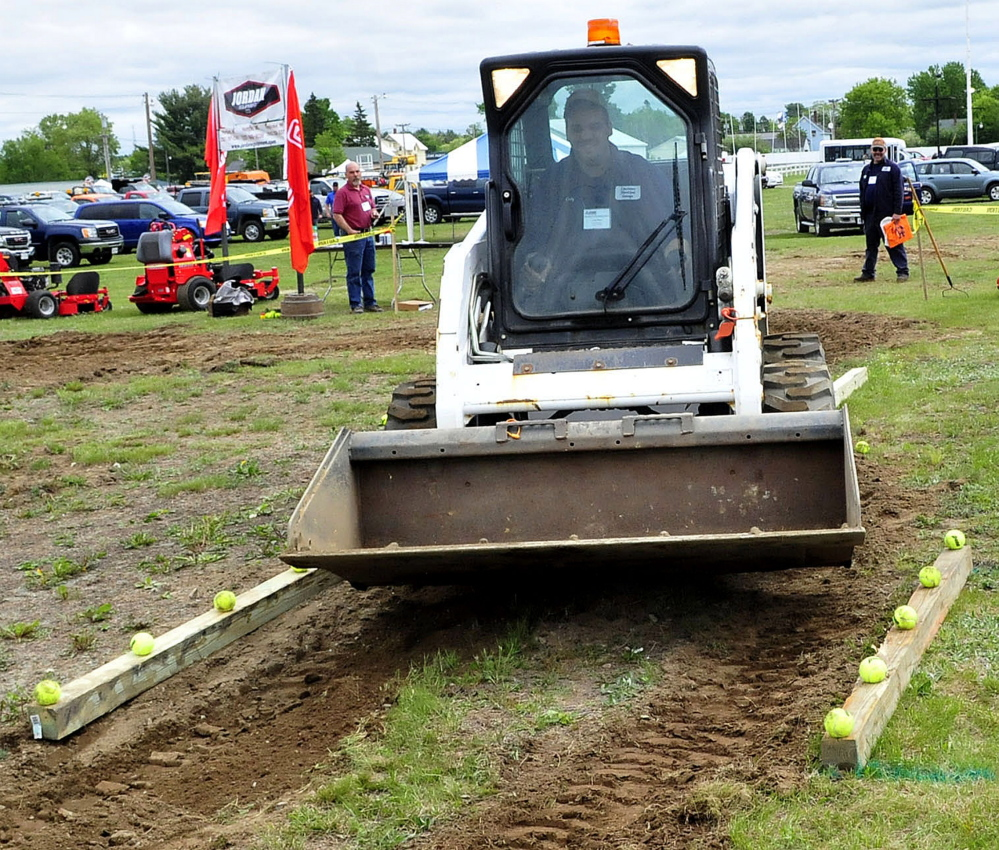 Cody Pleau competes in the skid steer competition Thursday during the American Public Works Highway Congress at the Skowhegan Fairgrounds.