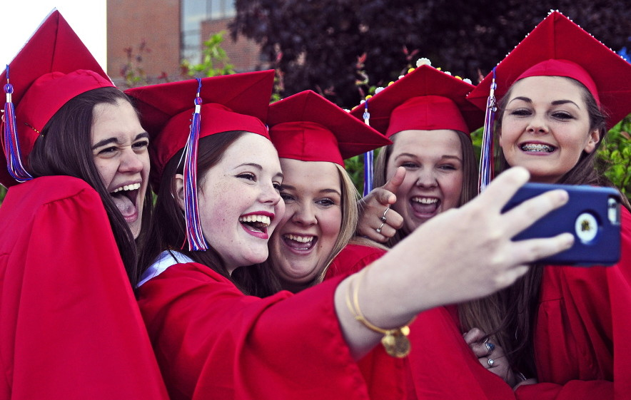 From left, graduates Marisa Schaller, Emma Walsh, Jamie Thomas, Jessie Thomas and Kalea Proctor take a selfie Thursday before the Messalonskee High School graduation at the Augusta Civic Center.