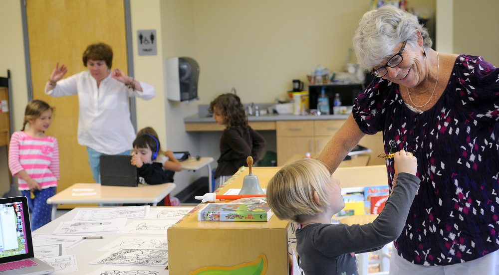 Hall-Dale Elementary School pre-kindergarten teacher Sue Dodge works with students earlier this week at the Hallowell school, where she has taught for more than 40 years. Dodge is retiring from a career she says she still loves.
