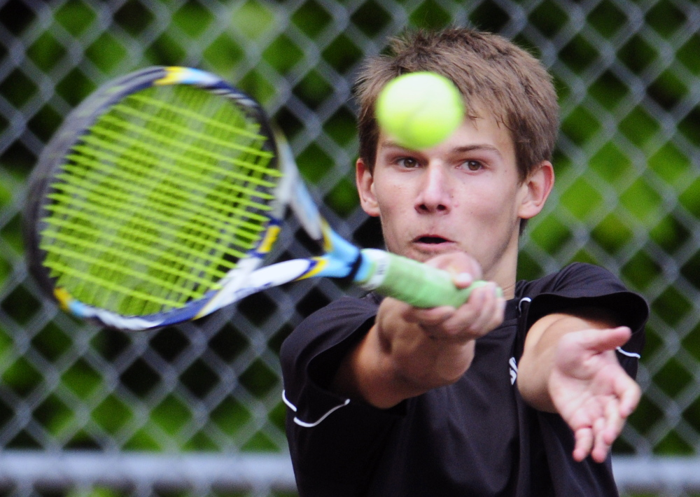 Staff photo by Joe Phelan Hall-Dale's Jacob Young returns a shot to St. Dominic's Elliot Hachey during the third singles match of a Western C semifinal against St. Dom's on Friday in Farmingdale. Young won 6-4, 6-2.