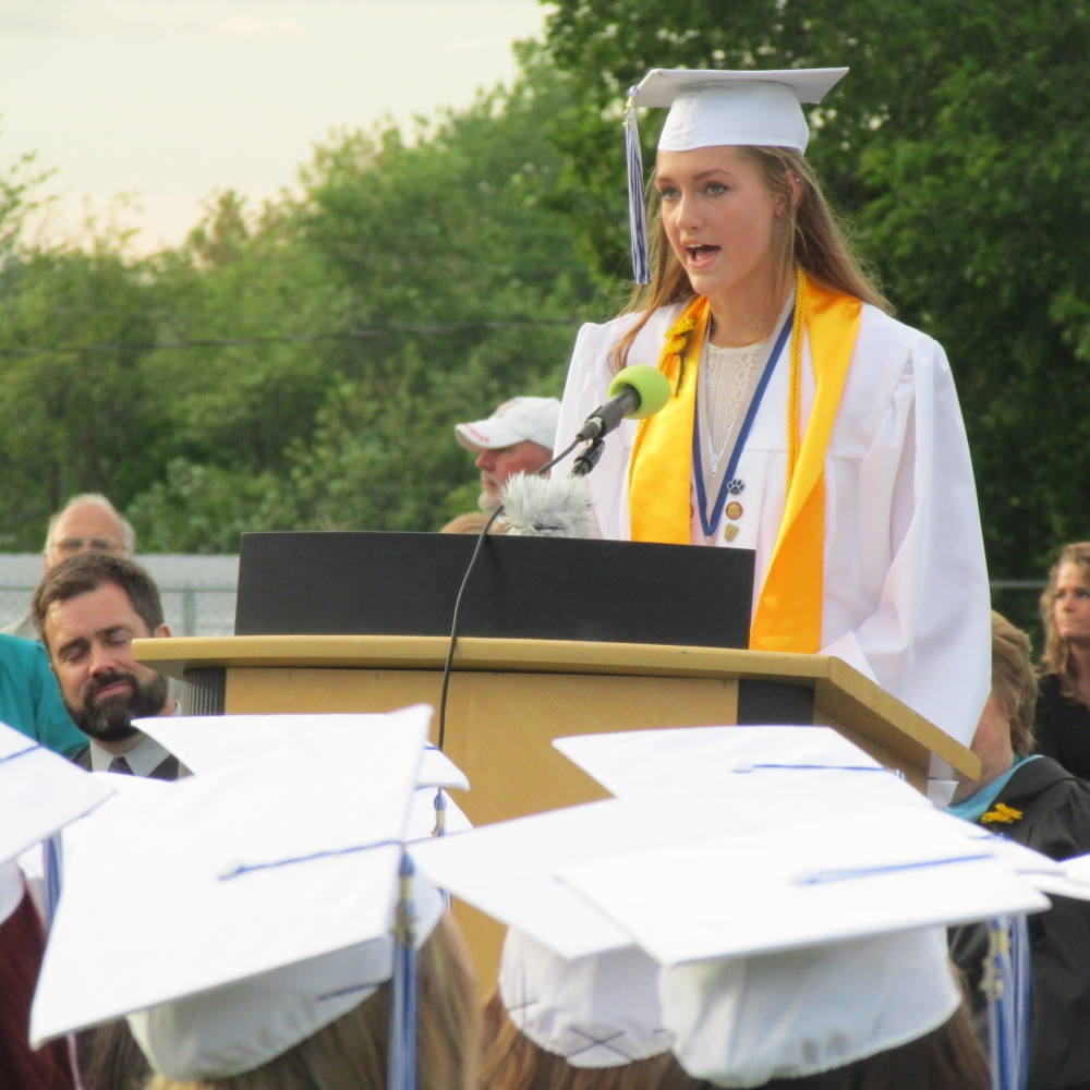 Lawrence High School Valedictorian Abigail Weigang addresses fellow graduates during a graduation ceremony Friday evening at the Lawrence High School football field in Fairfield.