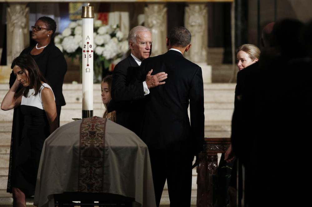 Vice President Joe Biden pats President Barack Obama on the back during funeral for Biden's son, Beau Biden, Saturday, June 6, 2015, in Wilmington, Del. (Kevin Lamarque/Pool Photo via AP)