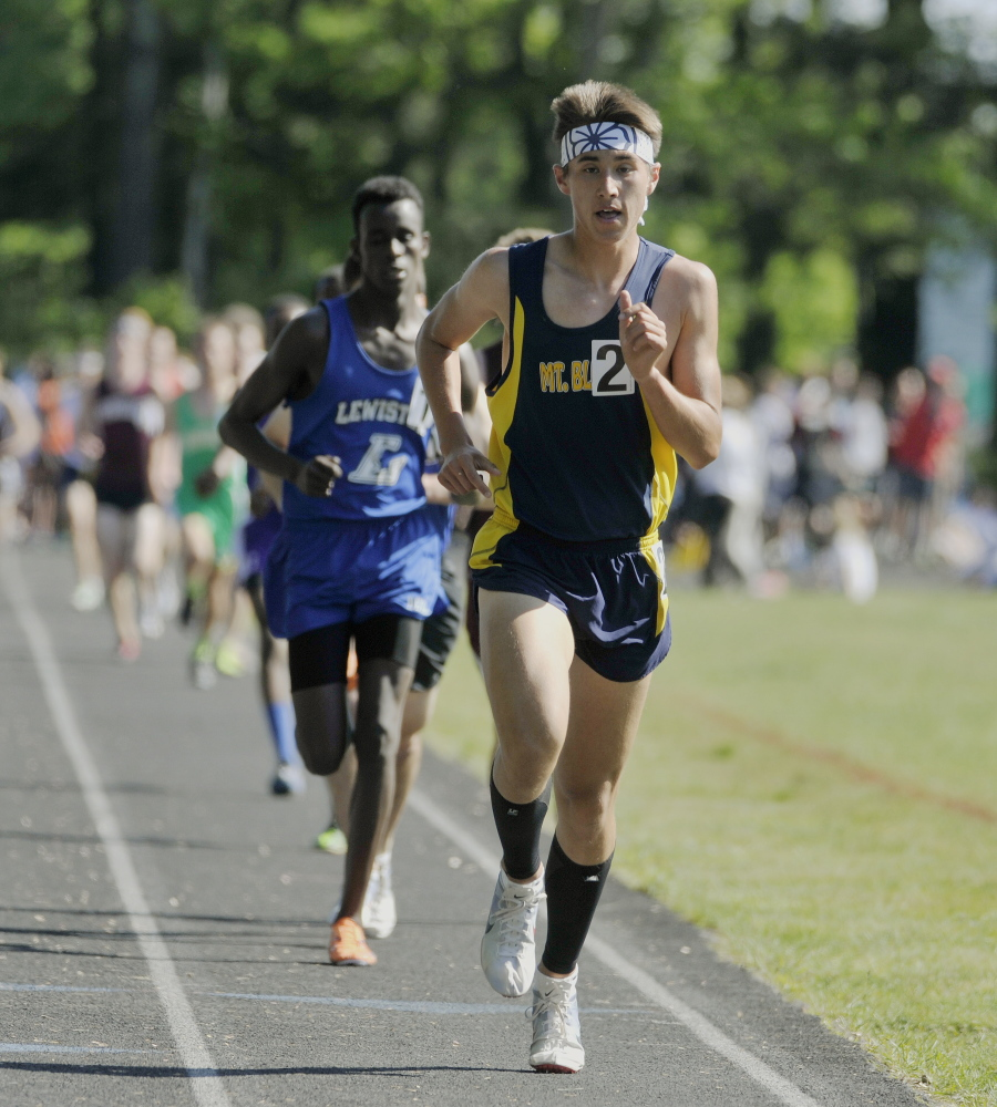 Portland Press Herald photo by John Ewing   Mt. Blue senior Aaron Willingham out-paces the field in the 3,200-meter run at the Class A state track and field championships Saturday at Mt. Ararat in Topsham. Willingham won the event in 9 minutes, 39.80 seconds.
