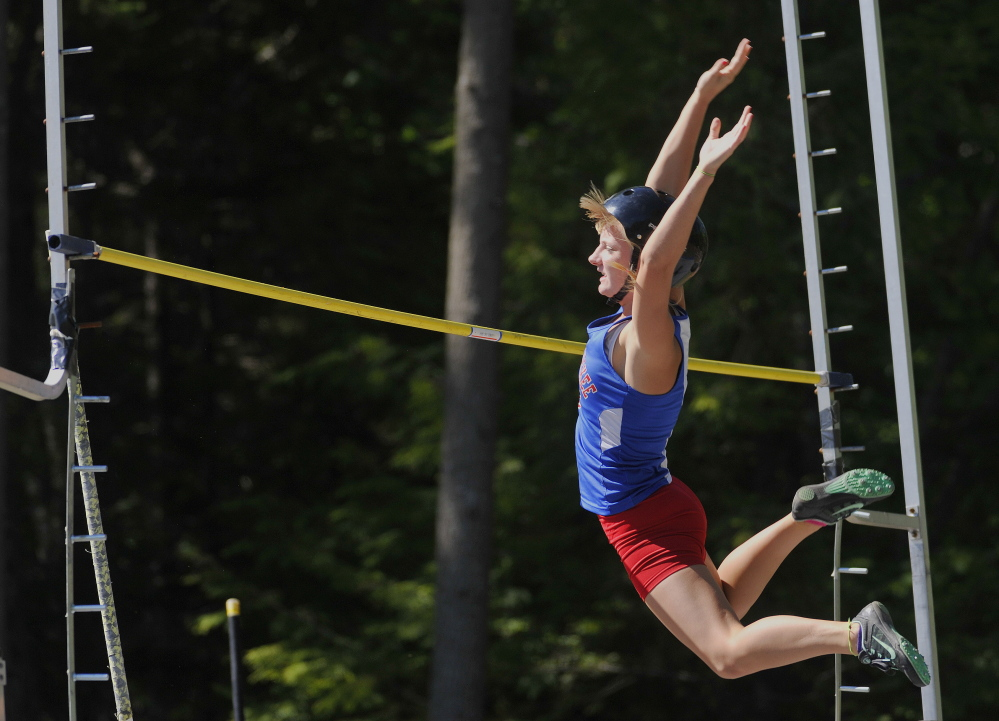 Portland Press Herald photo by John Ewing   Messalonskee's Taylor Lenentine clears the bar in the pole vault during the Class A state track and field championships Saturday at Mt. Ararat in Topsham. Lenentine won the event by clearing 10 feet.