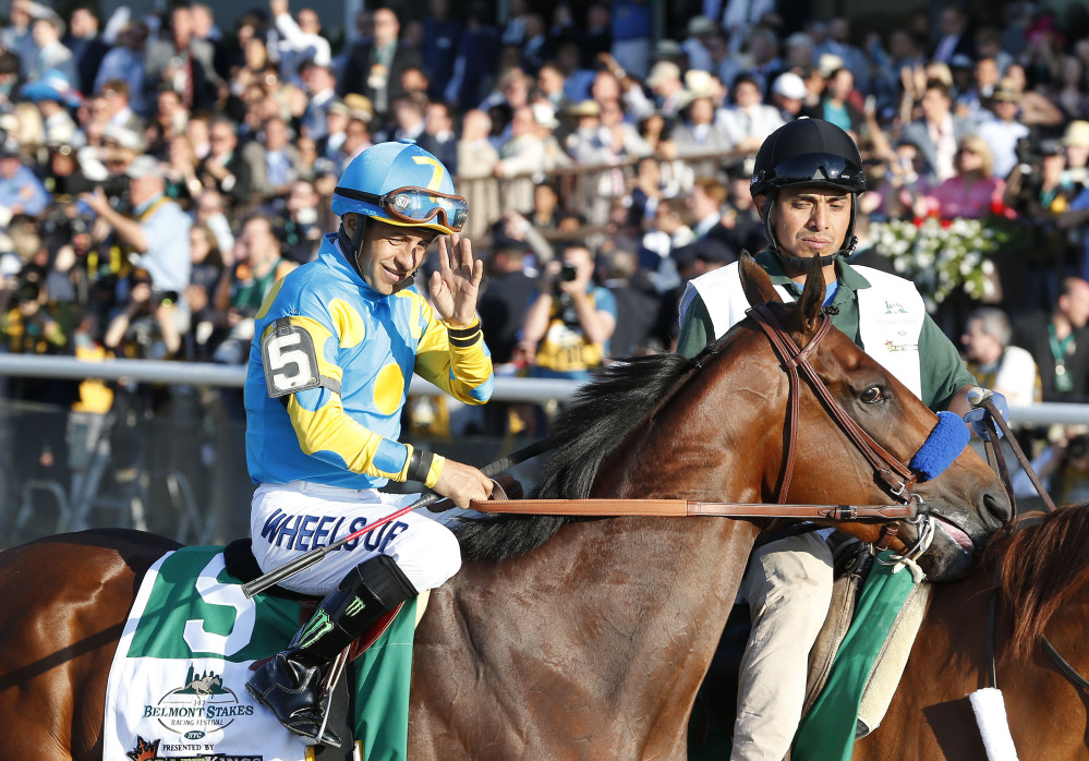 American Pharoah (5) with Victor Espinoza up parades to the starting gate before the 147th running of the Belmont Stakes horse race at Belmont Park, Saturday in Elmont, N.Y.