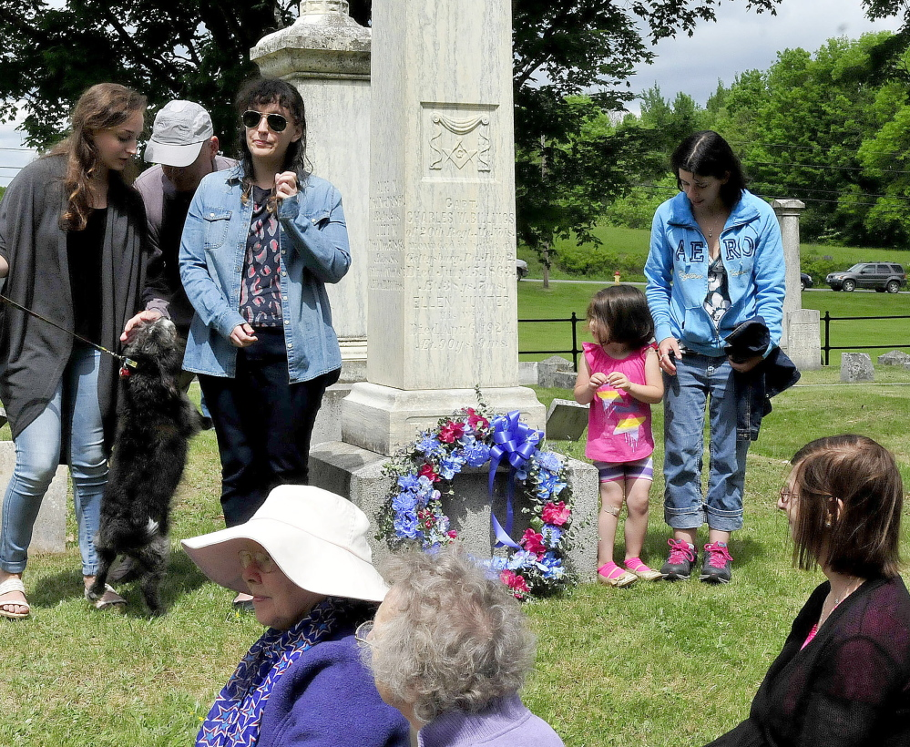Descendants of Civil War casualty Capt. Charles Billings stand beside Billings' rededicated grave Saturday after placing a wreath during a Civil War re-enactment event in Clinton. Billings served in the 20th Maine Volunteer Infantry Regiment, was wounded in 1863 during the Battle of Gettysburg and died shortly afterward.