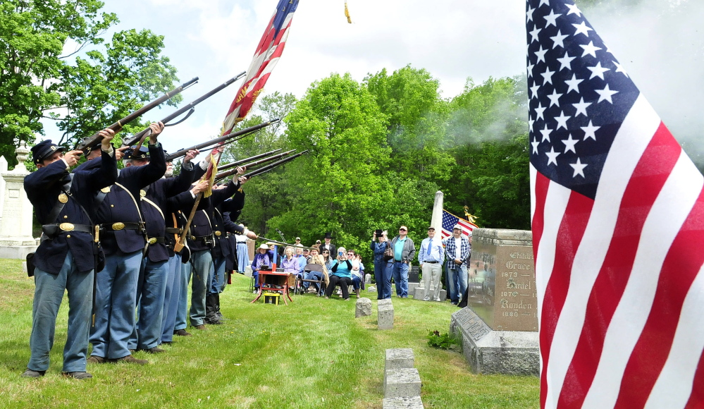A 20th Maine Volunteer Infantry Regiment re-enactors group performs a 21-gun salute Saturday during a rededication ceremony at the grave of Capt. Charles Billings in Clinton.