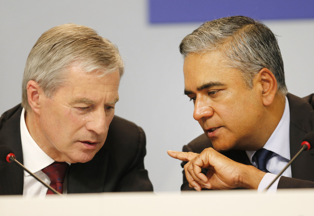 Co-CEOs of Deutsche Bank Anshu Jain, right, and Juergen Fitschen will resign. John Cryan will succeed Jain in July 2015 and will become the sole CEO in May 2016.