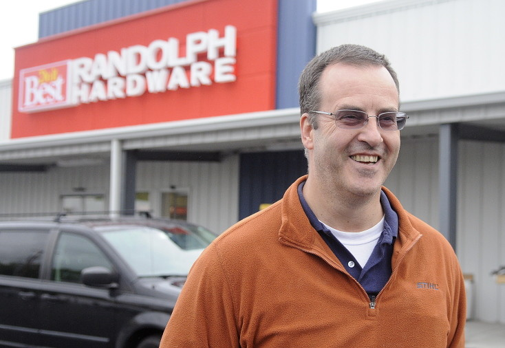 Robert Gardiner at his new business, Randolph Hardware, on Tuesday in Randolph, where the store's location in the federal floodplain meant he had to spend more on construction.
