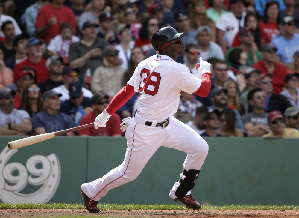Boston's Rusney Castillo hits a home run off a pitch by Oakland's Kendall Graveman in the eighth inning Sunday in Boston.