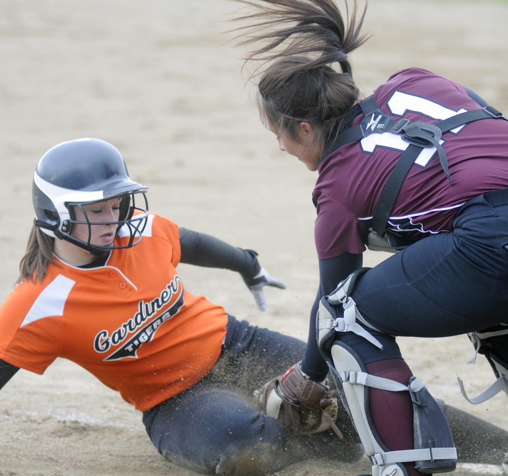 Gardiner Area High School's Bri Brochu gets tagged at home by Nokomis catcher Mikayla Charters earlier this season in a Kennebec Valley Athletic Conference Class B game. No. 9 Nokomis will travel to Presque Isle on Tuesday for a preliminary-round game. Gardiner, the top seed in Eastern Class B, will play the winner of that game on Thursday.