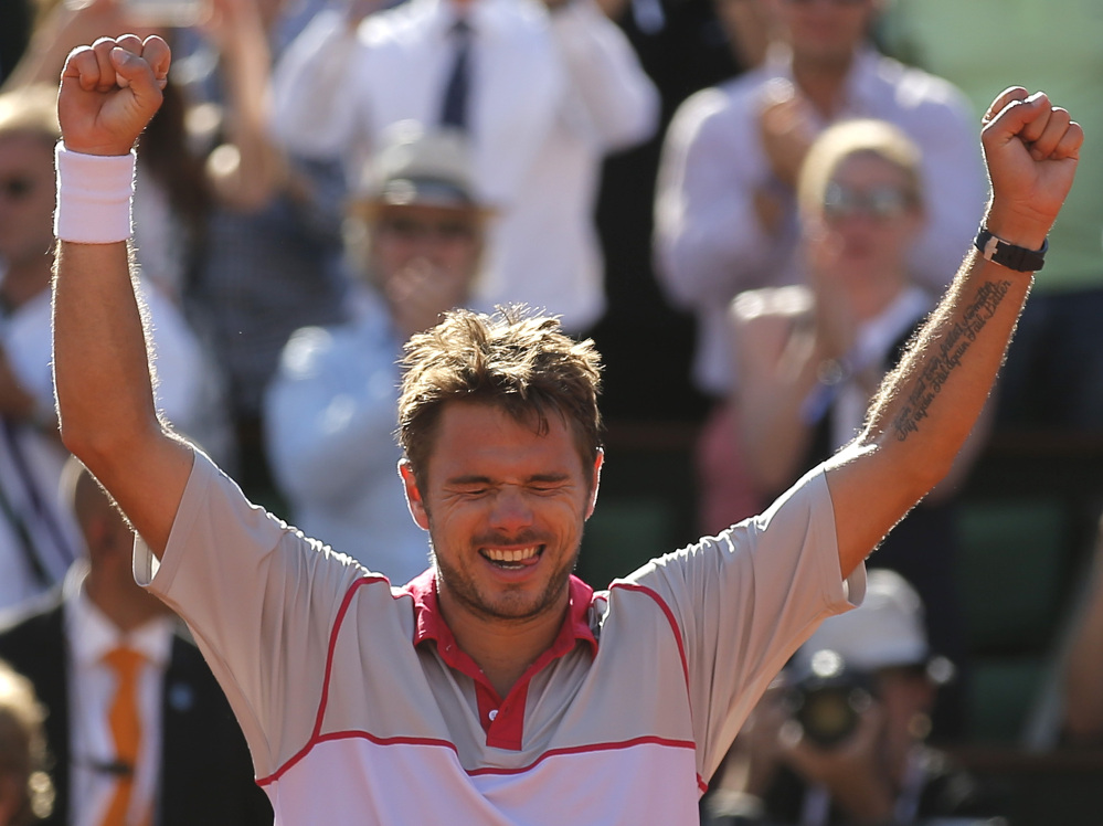Stan Wawrinka celebrates after defeating Novak Djokovic in their final match at the French Open on Sunday at Roland Garros stadium in Paris. Wawrinka won 4-6, 6-4, 6-3, 6-4.