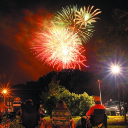 Fireworks light up the sky over the Hathaway Creative Center in Waterville on July 4 last year. The fireworks show was part of the Winslow Family 4th of July Celebration. Organizers of the annual event are meeting with Fairfield officials Wednesday  to discuss moving it to that town next year.