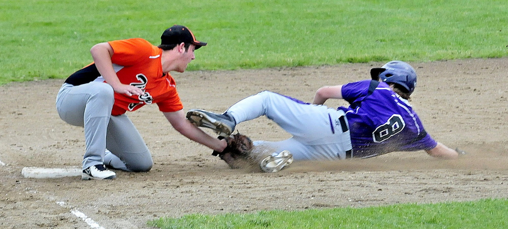 Gardiner's Brady Smith tags out Waterville's Cody Pellerin at third base during an Eastern B prelim Tuesday in Waterville. The Panthers won 3-2.