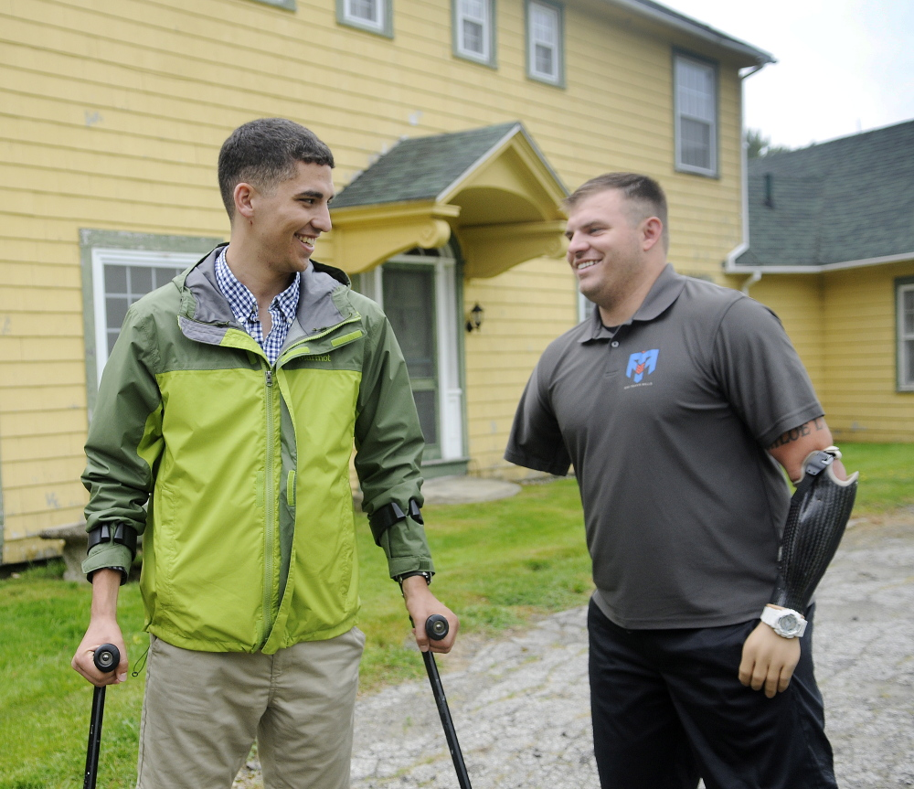Travis Mills, right, greets John Bobrowiecki at the Travis Mills Foundation National Family Retreat Center in Rome. A kickoff for the renovation and restoration of the retreat for combat-wounded and disabled veterans and their families was held, with several injured veterans in attendance.