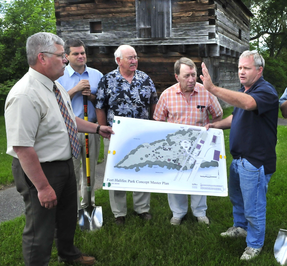 Winslow officials and committee members, shown Wednesday, discuss the Fort Halifax improvement project that will begin this summer in Winslow. The $200,000 project will include relocation of the parking lot area and trails to enhance the historic fort site, background. From left are Town Manager Mike Heavener, Jim Bourgoin, Ken Fletcher, Gerald Saint Amand and Ray Caron.