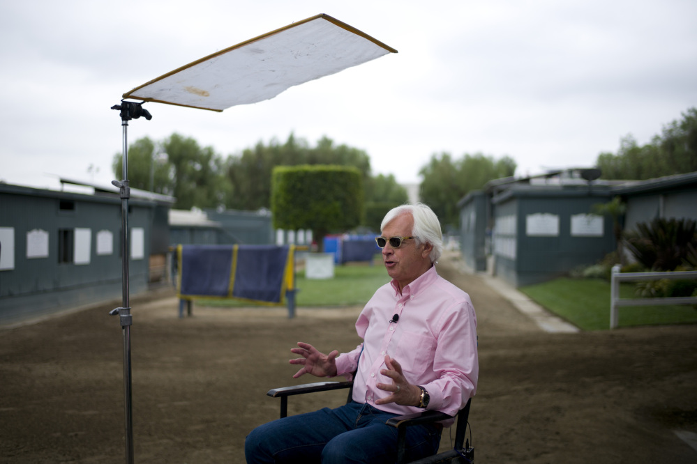 AP photo   Bob Baffert, the trainer for Triple Crown-winning horse American Pharoah, gives an interview with a television station at Santa Anita Park on Wednesday in Arcadia, Calif.