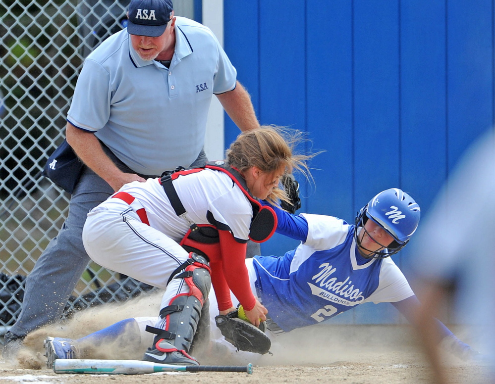 Staff file photo by Michael G. Seamans   Madison's Erin Whalen, right, slides safely under the tag from Hall-Dale catcher Emma Begin during the Mountain Valley Conference title game recently. Madison and Hall-Dale are the top two seeds, respectively, in the Western C playoffs.