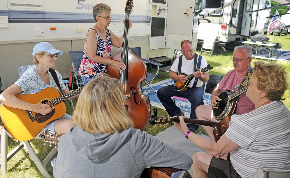 LITCHFIELD, ME - JUNE 19: Guests at the Blistered Fingers Family Bluegrass Music Festival pick together Thursday June 19, 2014 at the Litchfield Fairgrounds.  Bluegrass acts start Wednesday on the main stage and performances continue through Saturday.(Photo by Andy Molloy/Staff Photographer)