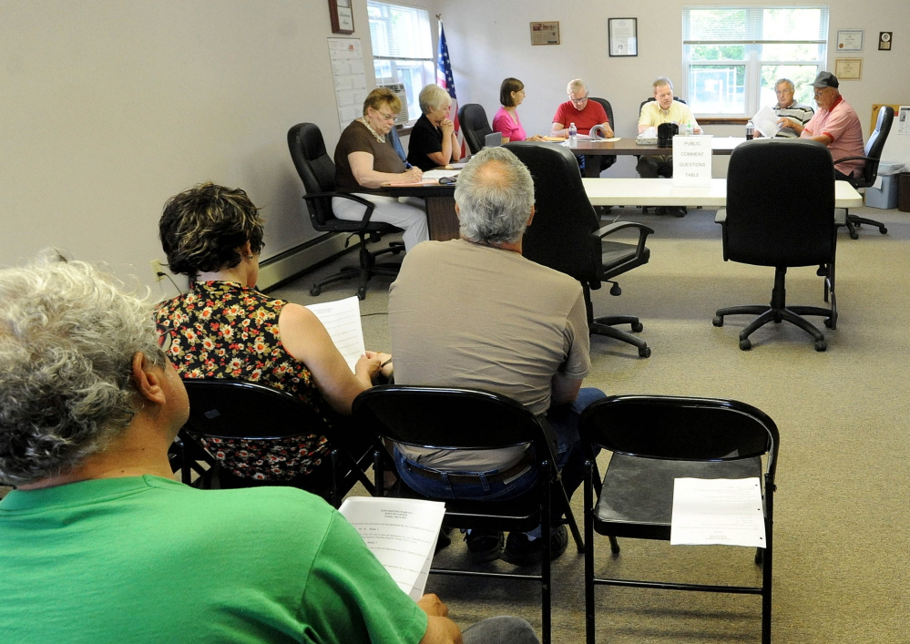 Clinton residents attend a selectmen's meeting Thursday. The board decided to hold a referendum on the police budget, the most recent version of which was rejected Tuesday at the ballot box.